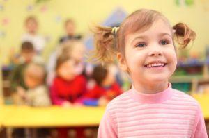 iStock_little-smiling-girl-in-kindergarten
